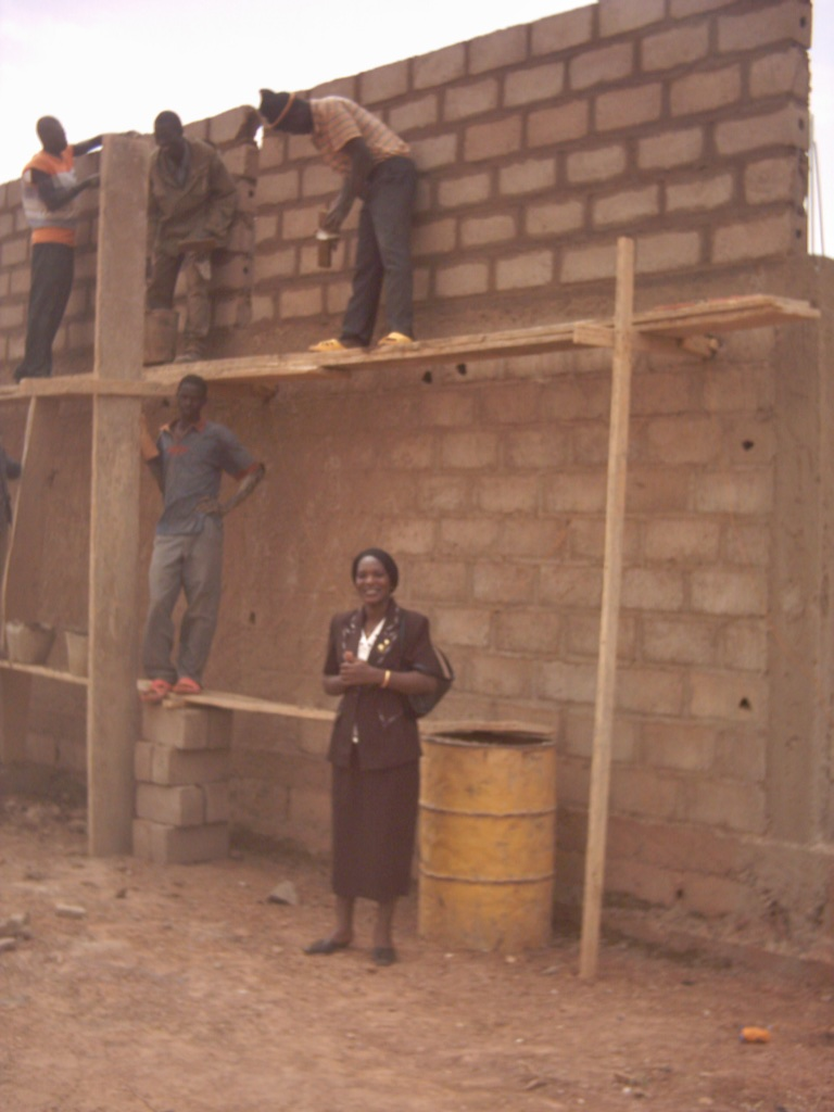 The president of NEEED witnessing construction.