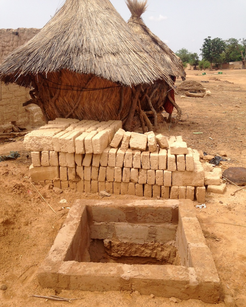 Cement interior border and local mud bricks for latrine enclosure walls