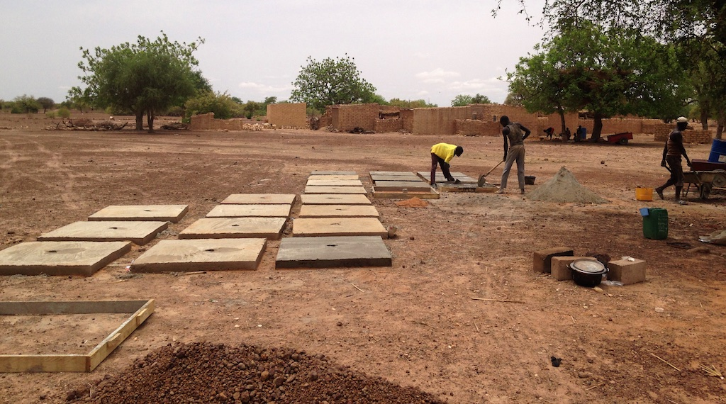 masons building the latrine platforms