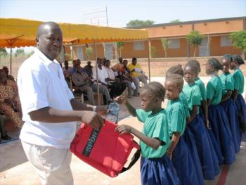 Director of Association NEEED delivering supplies to incoming students.
