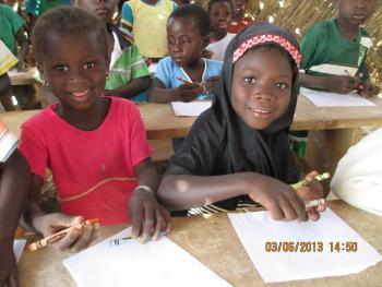 Children thrilled to receive crayons and a sheet of paper.